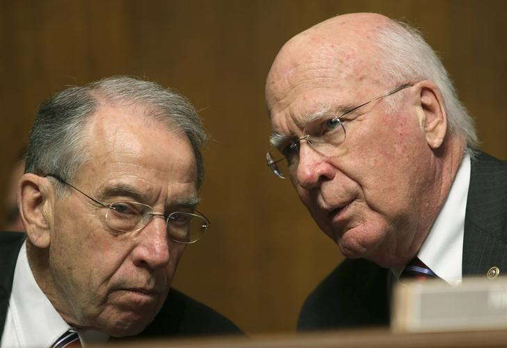 The chairman of the Senate Judiciary Committee, Senator Patrick Leahy (D-VT) (R) and Senator Chuck Grassley (R-IA) (L), confer before listening to NSA Director General Keith Alexander (not pictured) in Washington December 11, 2013. REUTERS/Gary Cameron