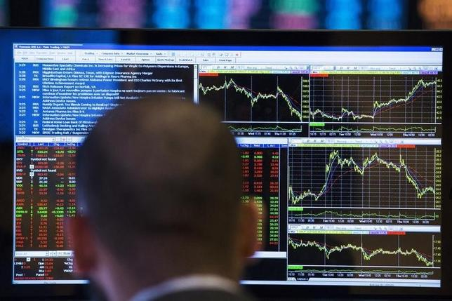 A trader looks at his screen as he works on the floor of the New York Stock Exchange March 13, 2014.  REUTERS/Lucas Jackson