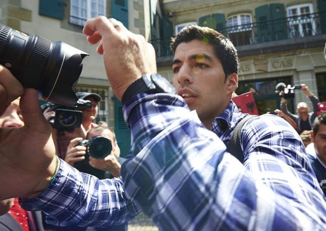 Uruguayan striker Luis Suarez leaves after his hearing at the Court of Arbitration for Sport (CAS) in Lausanne August 8, 2014. REUTERS/Denis Balibouse