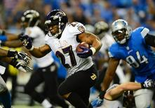 Dec 16, 2013; Detroit, MI, USA; Baltimore Ravens running back Ray Rice (27) runs the ball during the third quarter against the Detroit Lions at Ford Field. Mandatory Credit: Andrew Weber-USA TODAY Sports