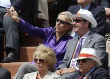 Former tennis player Martina Navratilova (L top) watches the women's singles final match between Sara Errani of Italy and Maria Sharapova of Russia during the French Open tennis tournament at the Roland Garros stadium in Paris June 9, 2012.               REUTERS/Gonzalo Fuentes