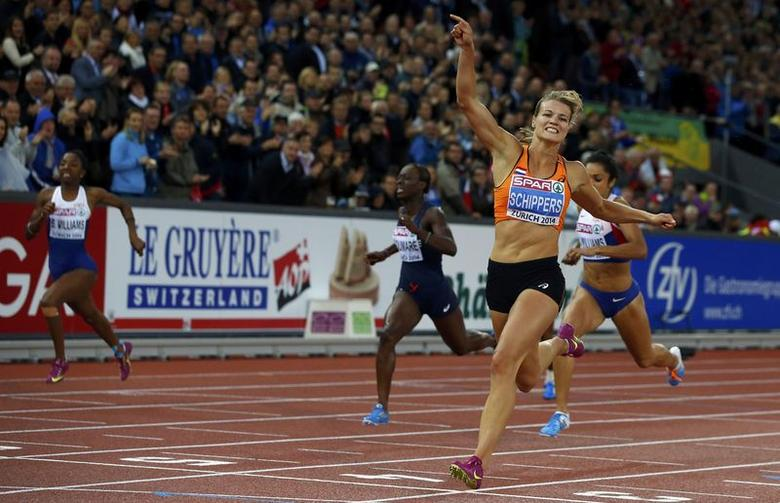 Dafne Schippers of the Netherlands celebrates as she crosses the finish line to win the women's 200 metres final during the European Athletics Championships at the Letzigrund Stadium in Zurich August 15, 2014. REUTERS/Phil Noble