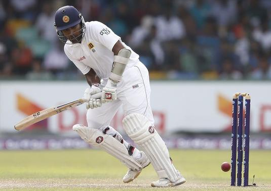 Sri Lanka's Mahela Jayawardene plays a shot during the third day of their second and final test cricket match against Pakistan in Colombo August 16, 2014. REUTERS/Dinuka Liyanawatte