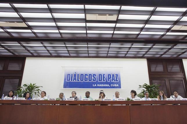 Victims of the Colombian armed conflict attend a conference for peace talks between Revolutionary Armed Forces of Colombia (FARC) and the Colombian government in Havana August 16, 2014. The banner reads, ''Dialogue of peace''. REUTERS/Alexandre Meneghini
