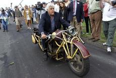 TV personality Jay Leno rides a 1930 Bohmerland motorcycle around the grounds during the Concours d'Elegance at the Pebble Beach Golf Links in Pebble Beach, California, August 17, 2014.  REUTERS/Michael Fiala