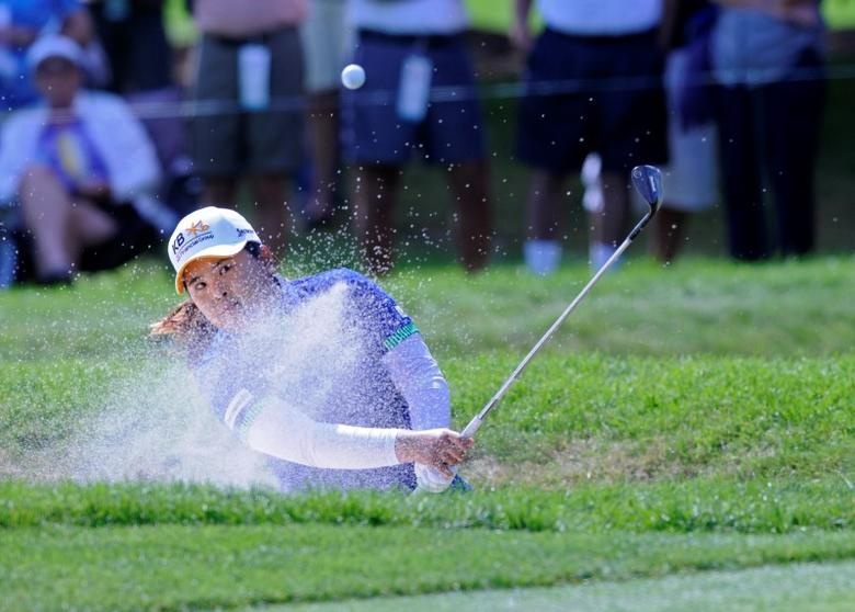 Inbee Park hits a shot out of a sand trap off the 3rd hole during the final round of the Wegman's Championship golf tournament at Monroe Golf Club. Mark Konezny-USA TODAY Sports