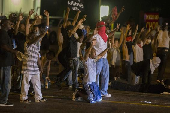 Demonstrators face off with police after tear gas was fired at protesters reacting to the shooting of Michael Brown in Ferguson, Missouri August 17, 2014. REUTERS-Lucas Jackson