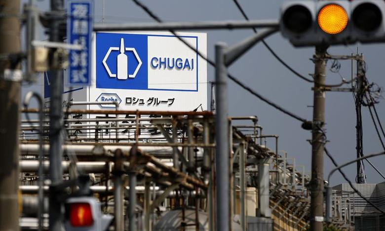 A signboard of Chugai Pharmaceutical Co is seen at the company factory in Tokyo August 18, 2014.   REUTERS/Toru Hanai