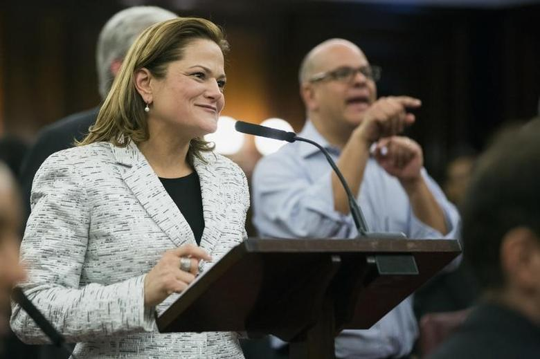 New York City councilwoman Melissa Mark-Viverito smiles as she speaks after being elected speaker of the city council inside of City Hall in the Manhattan borough of New York January 8, 2014. REUTERS/Lucas Jackson
