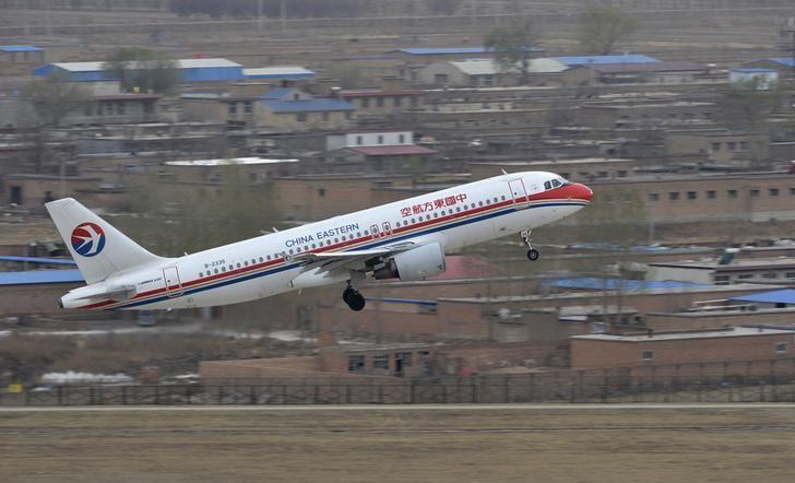 A China Eastern Airlines plane takes off at an airport in Taiyuan, Shanxi province, April 5, 2013.  REUTERS/Jon Woo