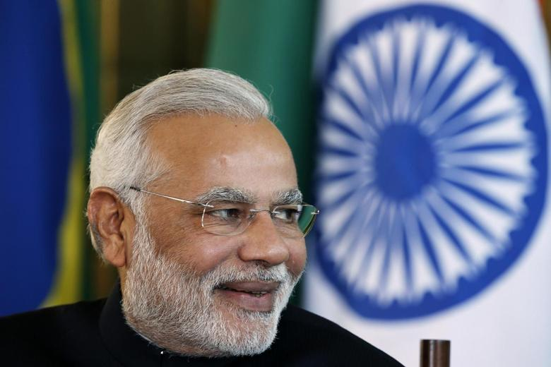 Prime Minister Narendra Modi reacts during a meeting with Brazil's President Dilma Rousseff (not pictured) on the sidelines of the 6th BRICS summit at the Alvorada Palace in Brasilia July 16, 2014. REUTERS/Ueslei Marcelino/Files