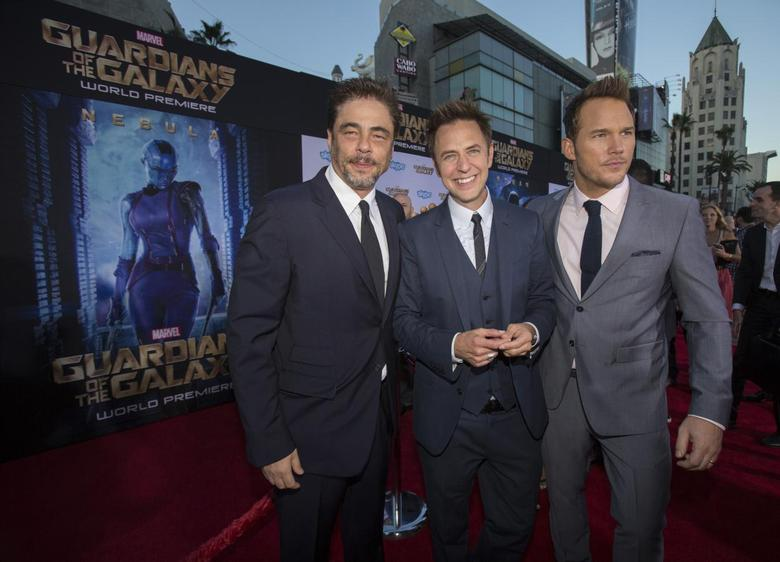 Director of the movie James Gunn (C) poses with cast members Benicio Del Toro (L) and Chris Pratt at the premiere of ''Guardians of the Galaxy'' in Hollywood, California July 21, 2014.  REUTERS/Mario Anzuoni