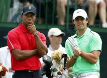 Tiger Woods of the U.S. talks to Rory McIlroy of Northern Ireland on the tee of the 12th hole during the final round of the Memorial Tournament at Muirfield Village Golf Club in Dublin, Ohio in this file photo from June 2, 2013.  REUTERS/Matt Sullivan