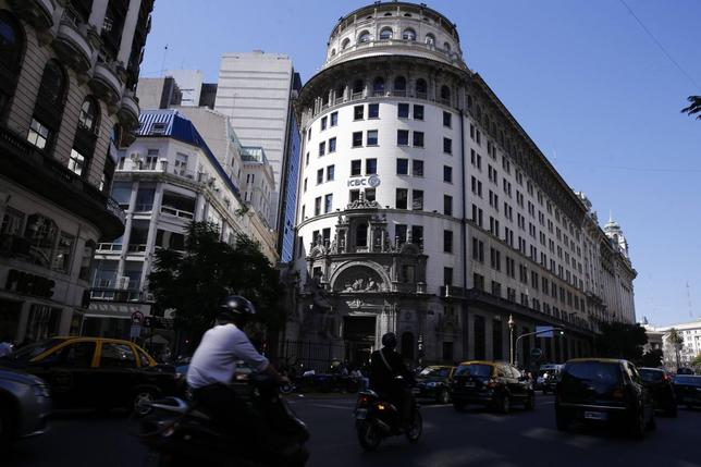 Cars and motorcycles drive by the ICBC (Industrial and Commercial Bank of China) building in Buenos Aires' financial district, August 20, 2014.  REUTERS/Marcos Brindicci