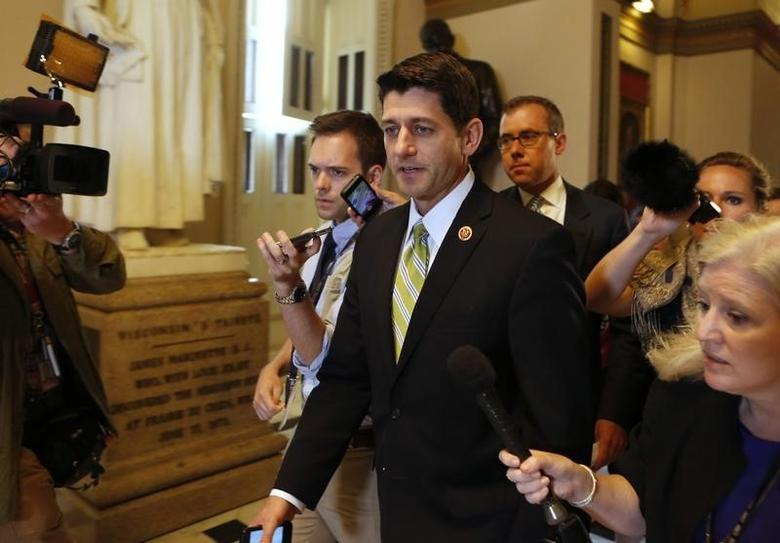 House Budget Committee Chairman Paul Ryan (R-WI) talks to reporters as he walks on the U.S. Capitol building in Washington June 11, 2014. REUTERS/Yuri Gripas