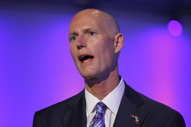 Florida Republican Gov. Rick Scott speaks at a ceremony opening new newsroom facilities for the Univision and Fusion television networks in Doral, Florida August 28, 2013.  REUTERS/Joe Skipper