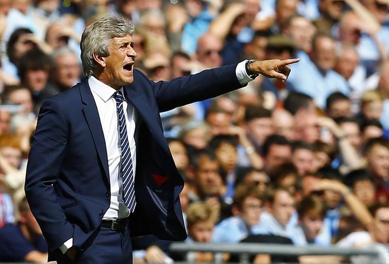 Manchester City manager Manuel Pellegrini reacts during their English Community Shield soccer match against Arsenal at Wembley Stadium in London, August 10, 2014. REUTERS/Darren Staples