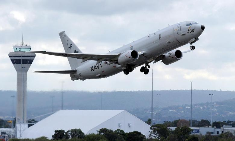 A U.S. Navy P-8 Poseidon aircraft takes off from Perth International Airport in this April 16, 2014 file photo.  REUTERS/Greg Wood/Pool/Files