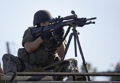 Obama orders review of U.S. police use of military...