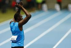 Usain Bolt of Jamaica reacts after winning the men's 100m race during the fifth Athletic Memorial, a tribute to deceased Olympic Champion Kamila Skolimowska, at the National Stadium in Warsaw August 23, 2014. REUTERS/Kacper Pempel