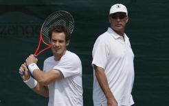 Andy Murray of Britain (L) trains with his coach Ivan Lendl on a practise court at the Wimbledon Tennis Championships, in London July 6, 2013.      REUTERS/Suzanne Plunkett
