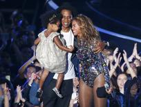 Beyonce smiles with Jay-Z and daughter Ivy Blue after accepting the Video Vanguard Award on stage during the 2014 MTV Video Music Awards in Inglewood, California August 24, 2014. REUTERS/Lucy Nicholson