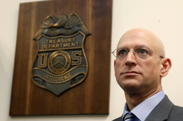 The Internal Revenue Service's Criminal Investigative Division Chief Richard Weber is pictured inside his office in Washington, August 14, 2014.   REUTERS/Larry Downing