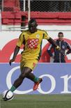 "JS Kabylie striker Albert Ebosse, from Cameroon, runs with the ball during  the Algeria Cup final soccer match against MC Alger in Algiers  May 1, 2014. The Confederation of African Football (CAF) have called for ""exemplary sanctions"" following the death of JS Kabylie striker Albert Ebosse, who was killed by a projectile thrown from the crowd in an Algerian league match on Saturday. Picture taken May 1, 2014.    REUTERS/LOUAFI LARBI ( ALGERIA - Tags: SPORT SOCCER)"