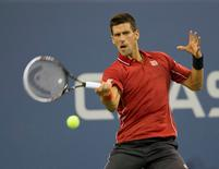 Aug 25, 2014; New York, NY, USA; Novak Djokovic (SRB) in action during his match against Diego Schwartzman (ARG) on day one of the 2014 U.S. Open tennis tournament at USTA Billie Jean King National Tennis Center. Mandatory Credit: Susan Mullane-USA TODAY Sports