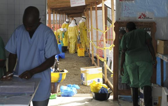 Medicins Sans Frontieres (MSF) health workers prepare at ELWA's hospital isolation camp during the visit of  Senior United Nations (U.N.) System Coordinator for Ebola, David Nabarro, in Monrovia August 23, 2014.  REUTERS/2Tango