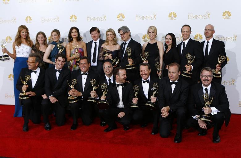 The cast and crew of AMC's ''Breaking Bad'' pose with their outstanding drama series award at the 66th Primetime Emmy Awards in Los Angeles, California August 25, 2014.  REUTERS/Mike Blake