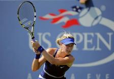 Canada's Eugenie Bouchard hits a return to Olga Govortsova of Belarus during their match at the 2014 U.S. Open tennis tournament in New York, August 26, 2014.  REUTERS/Eduardo Munoz