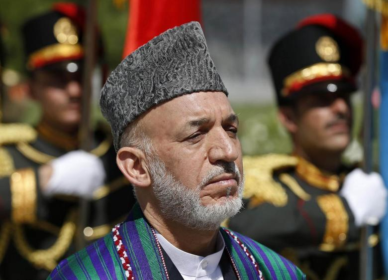 Afghan President Hamid Karzai attends an event to commemorate Afghanistan's 95th anniversary of independence in Kabul August 19, 2014. REUTERS/Omar Sobhani