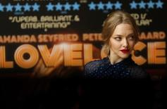 Actress Amanda Seyfried poses for photographers before a screening of her new film Lovelace at a hotel in Mayfair, London August 12, 2013. REUTERS/Andrew Winning