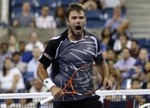 Stan Wawrinka of Switzerland celebrates after defeating Thomaz Bellucci of Brazil in a 4th set tie-break during their match at the 2014 U.S. Open tennis tournament in New York August 27, 2014.   REUTERS/Shannon Stapleton