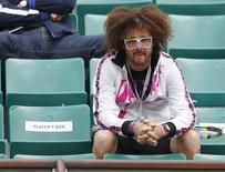 Redfoo, also known as Stefan Gordy of the band LMFAO, watches as his girlfriend Victoria Azarenka of Belarus plays Francesca Schiavone of Italy in their women's singles match during the French Open tennis tournament at the Roland Garros stadium in Paris June 3, 2013. REUTERS/Vincent Kessler
