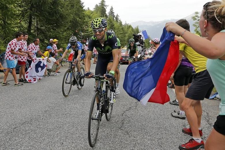 Movistar team rider Alejandro Valverde of Spain cycles to Risoul in the Alps mountains during the 177-km fourteenth stage of the Tour de France cycling race between Grenoble and Risoul, July 19, 2014.        REUTERS/Jean-Paul Pelissier