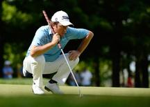Jul 26, 2014; Ile Bizard, Quebec, CAN; Tim Clark reads the green of the 12th hole during the third round of the RBC Canadian Open at Royal Montreal GC - Blue Course. Mandatory Credit: Eric Bolte-USA TODAY Sports