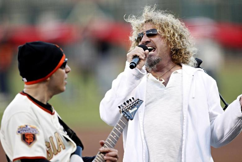 Musician Sammy Hagar (R) performs the country's national anthem before the MLB National League baseball game between the San Francisco Giants and the St. Louis Cardinals in San Francisco, California, in this April 9, 2011, file photo. REUTERS/Beck Diefenbach/Files
