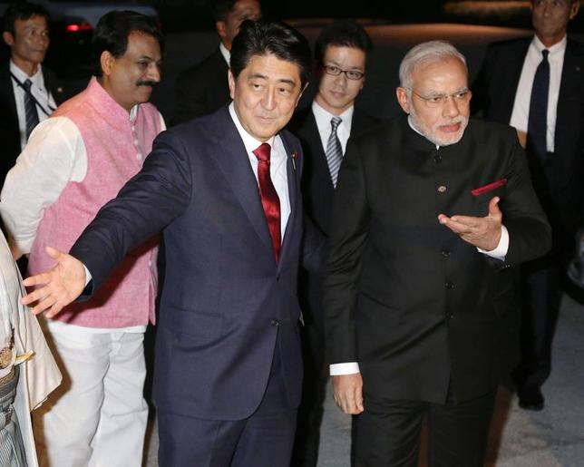 India's Prime Minister Narendra Modi (front R) is welcomed by Japan's Prime Minister Shinzo Abe (front L) upon his arrival at the State Guest House in Kyoto, western Japan, in this photo released by Kyodo August 30, 2014.   Mandatory credit    REUTERS/Kyodo