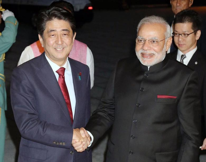 India's Prime Minister Narendra Modi (front R) shakes hands with Japan's Prime Minister Shinzo Abe upon his arrival at the State Guest House in Kyoto, western Japan, in this photo released by Kyodo August 30, 2014. REUTERS/Kyodo