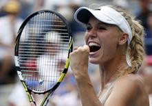 Caroline Wozniacki of Denmark celebrates her win over Maria Sharpova of Russia at the 2014 U.S. Open tennis tournament in New York, August 31, 2014.  REUTERS/Ray Stubblebine
