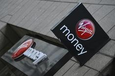 A logo at a branch of Virgin Money bank is seen in the City of London March 6, 2013. Virgin Money bought troubled British bank Northern Rock in 2012 for 747 million GBP. REUTERS/Toby Melville