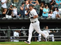 Aug 30, 2014; Chicago, IL, USA; Chicago White Sox designated hitter Adam Dunn (44) rounds the bases after hitting a home run against Detroit Tigers starting pitcher Max Scherzer (not pictured) during the third inning at U.S Cellular Field. Mandatory Credit: Mike DiNovo-USA TODAY Sports