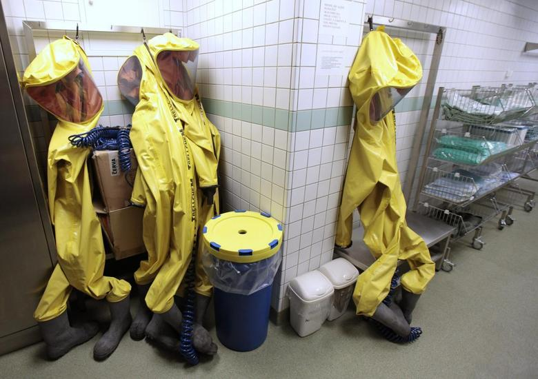 Protective gear of Czech military personnel wearing protective gear hang on hooks in the Biological Defence Centre, a specialised medical institution ensuring complete biological defence, in the village of Techonin August 11, 2014.   REUTERS/David W Cerny