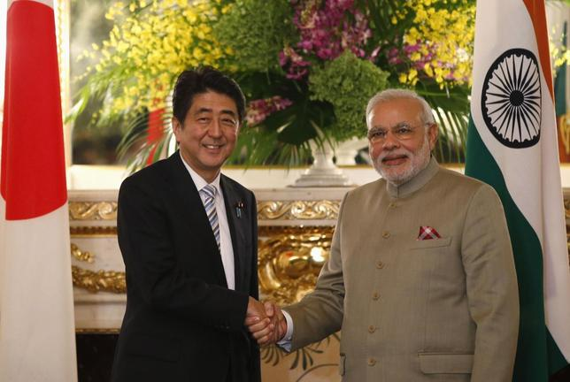 India's Prime Minister Narendra Modi (R) and Japan's Prime Minister Shinzo Abe shake hands before their talks at the state guest house in Tokyo September 1, 2014. REUTERS/Toru Hanai/Files
