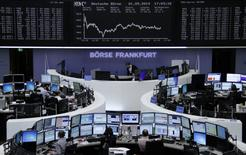 Traders are pictured at their desks in front of the DAX board at the Frankfurt stock exchange September 1, 2014.      REUTERS/Remote/Stringer