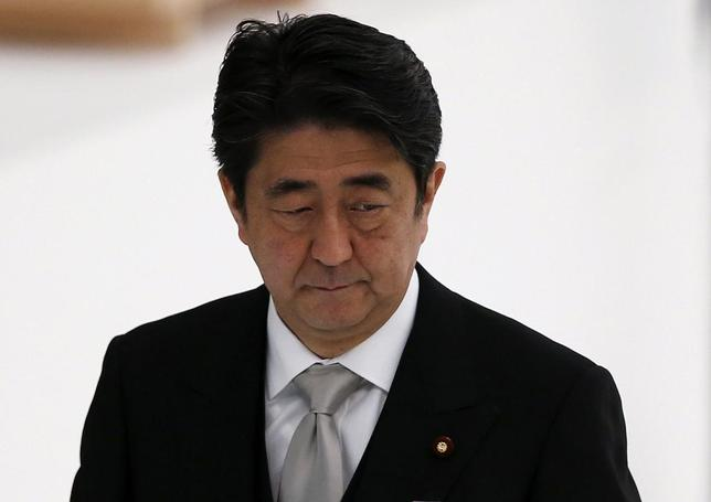 Japan's Prime Minister Shinzo Abe attends a memorial service ceremony marking the the 69th anniversary of Japan's surrender in World War Two, at Budokan Hall in Tokyo August 15, 2014. REUTERS/Toru Hanai