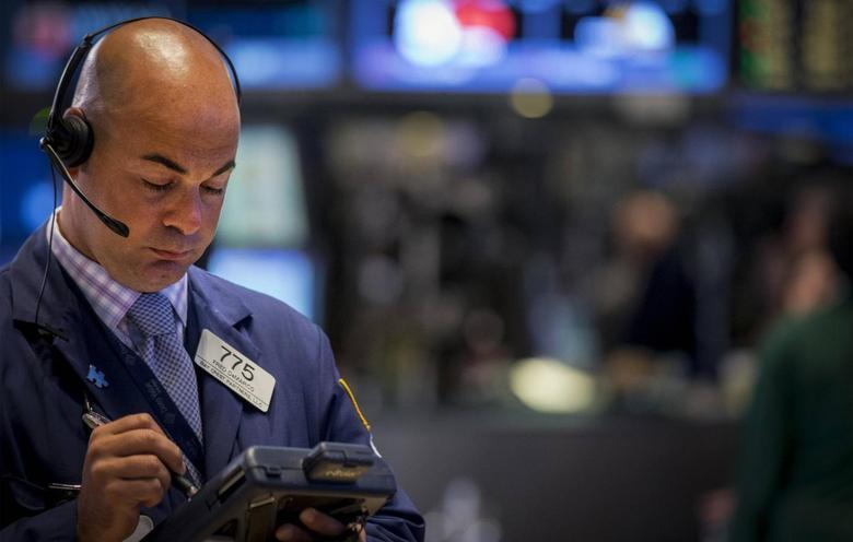 Trader Fred DeMarco works on the floor of the New York Stock Exchange September 2, 2014. REUTERS/Brendan McDermid