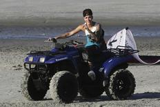 Canadian pop singer Justin Bieber drives a quad bike at the beach as he takes a break in a resort in Punta Chame on the outskirts of Panama City in a January 27, 2014 file photo. REUTERS/Carlos Jasso/files